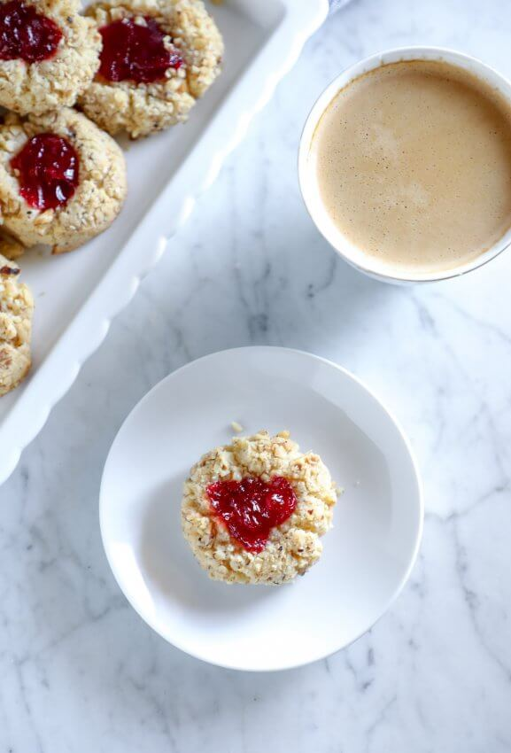 keto thumbprint cookies on a plate with coffee