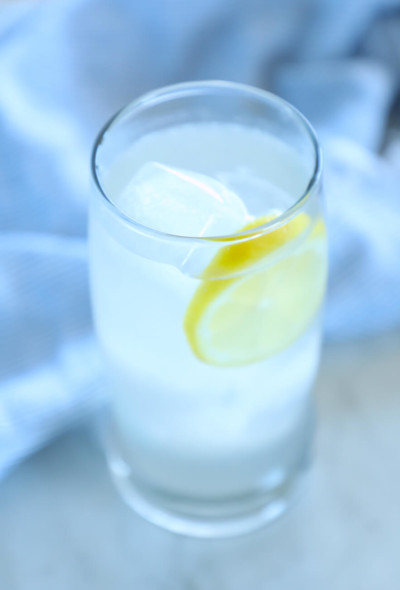 keto ginger lemon detox drink in a clear glass with ice