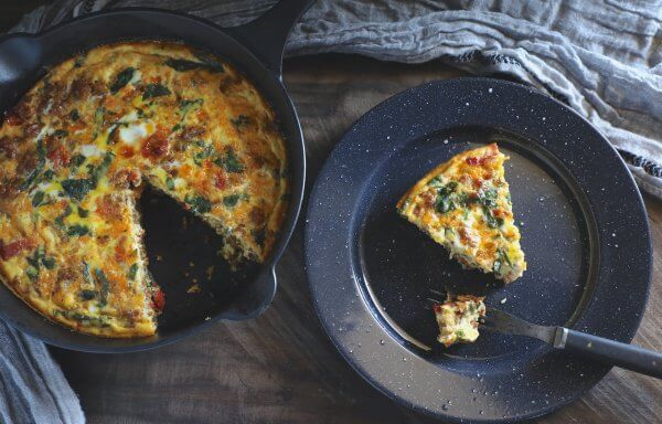Keto sausage frittata SCKC on a wooden cutting board
