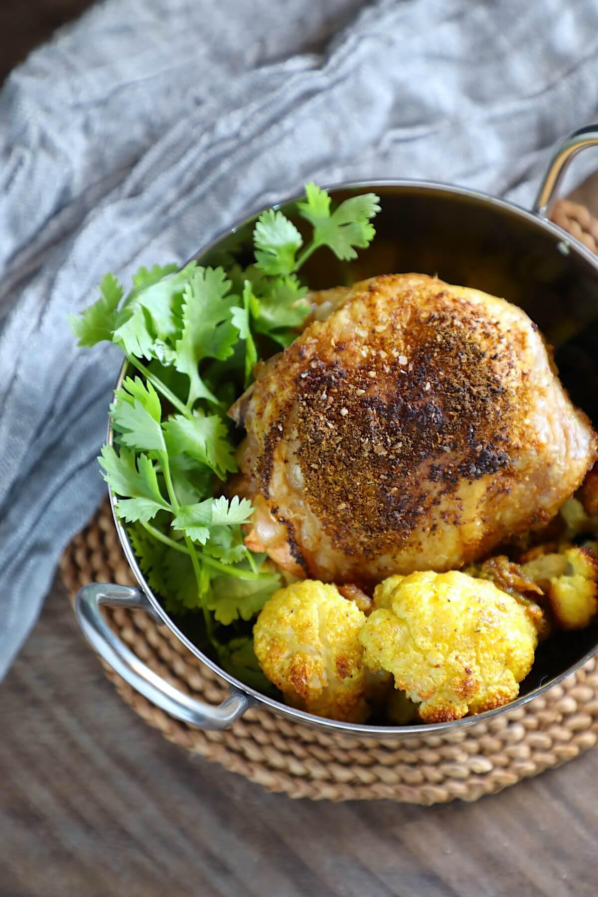 Keto sheet pan curried chicken - SCKC with cauliflower and cilantro garnish