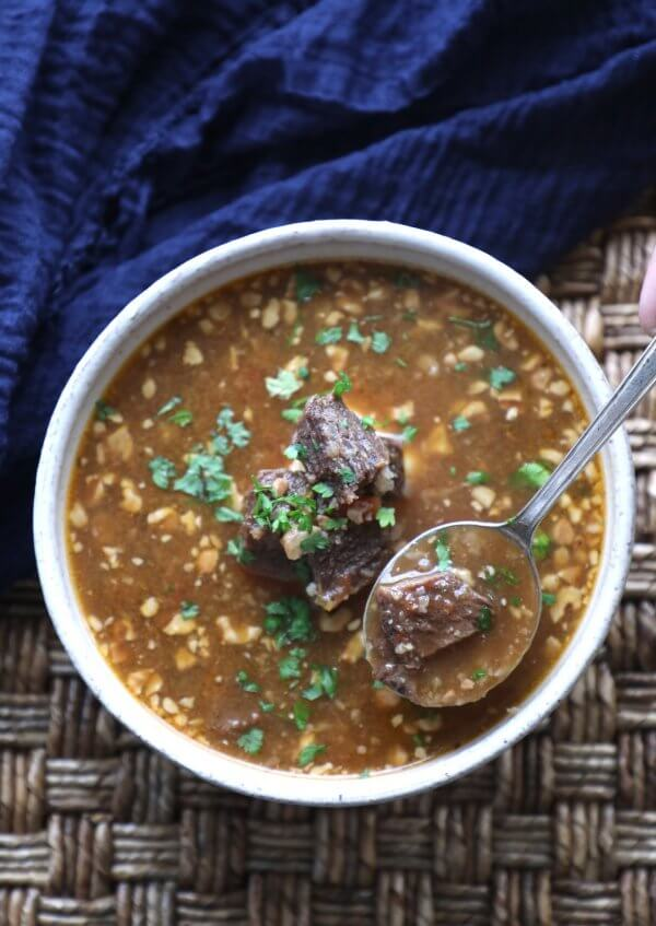 Instant Pot Keto Beef Barley Soup with a spoon from above