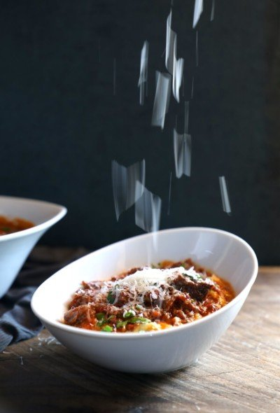 Keto Short Rib Ragu in the Instant Pot with parmesan cheese raining down onto it from above