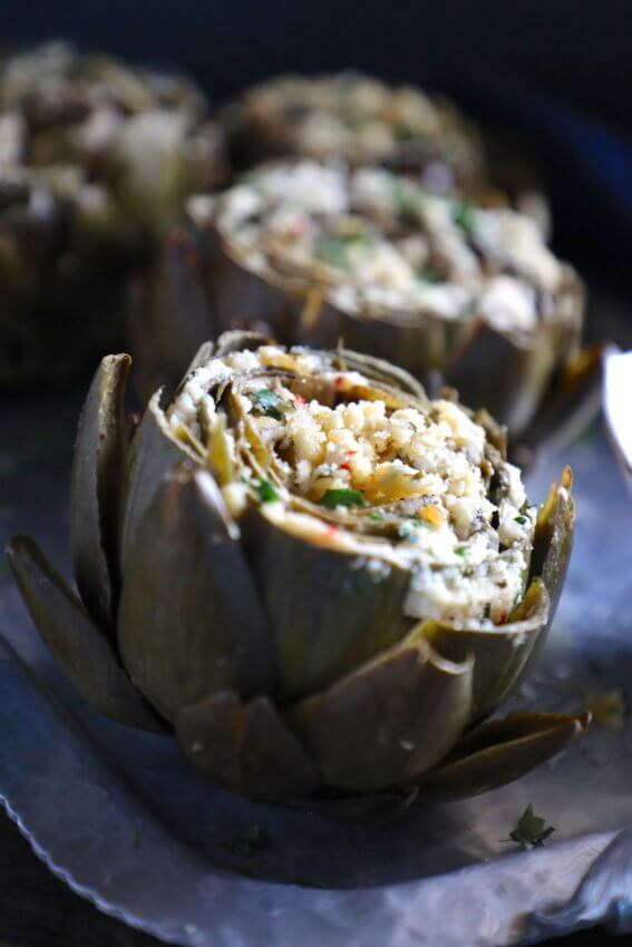 Keto Stuffed Artichokes on a silver platter