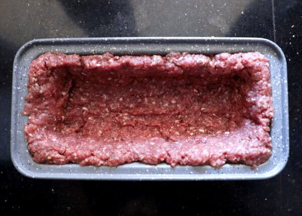 Ground beef in a loaf pan - Keto Lasagna Meatloaf step 1