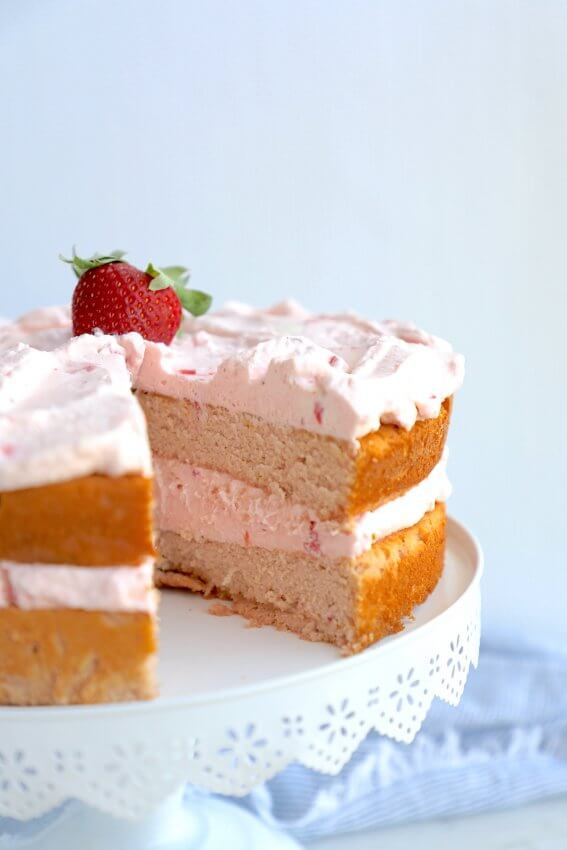 Keto Strawberry Mousse Cake with a slice removed showing the inside layers