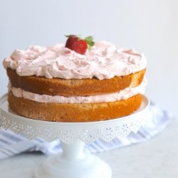 Keto Strawberry Mousse Cake on a white cake pedestal