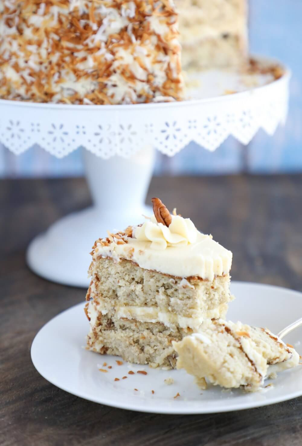 Slice of Keto Hummingbird Cake with a forkful on the white plate front view