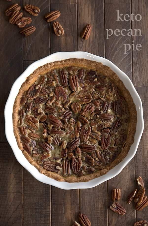 low carb pecan pie on wooden background in a white pie plate