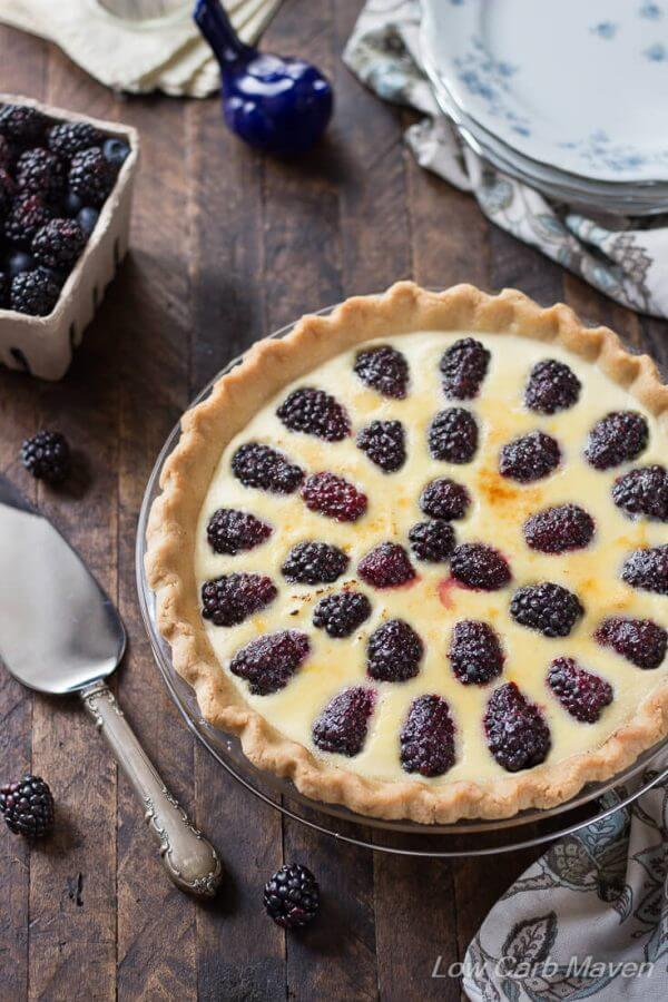 blackberry custard pie on wooden background