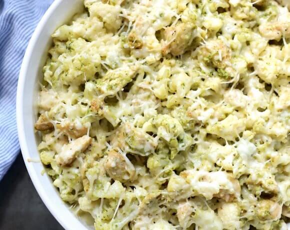 Top view of Keto Chicken Pesto Cauliflower Casserole in a round baking dish