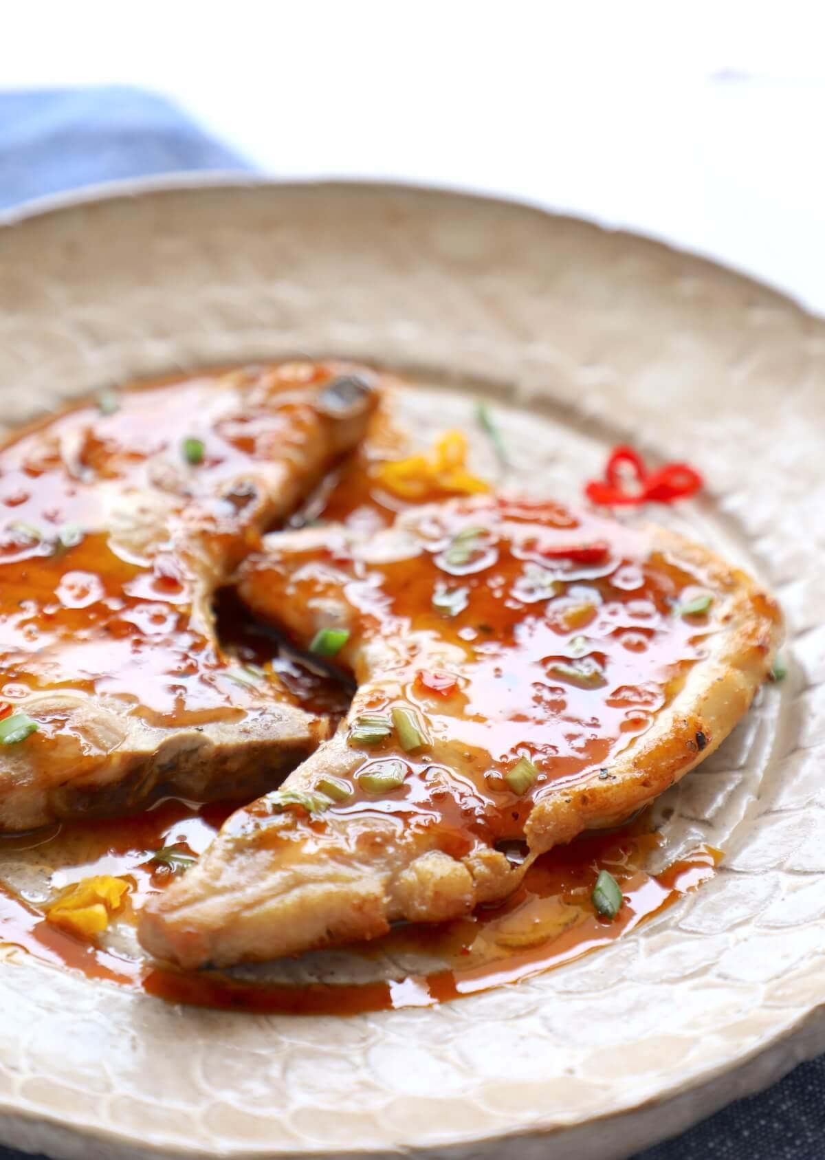Sweet Chili Keto Pork Chops garnished with scallions