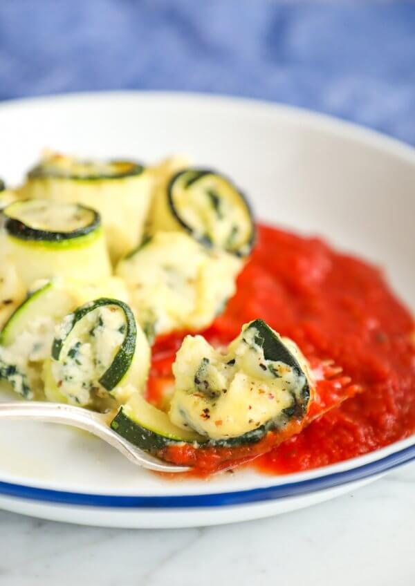 Keto Zucchini Rollatini on a fork with marinara sauce