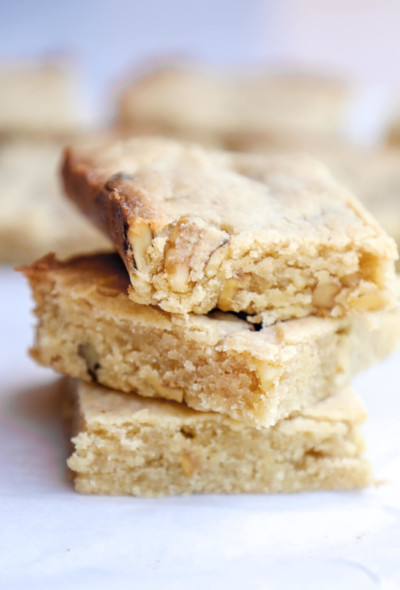 3 keto butter rum blondies stacked on top of each other to show texture