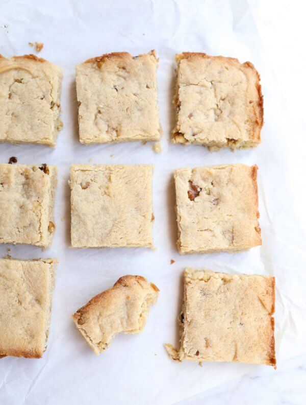 9 keto butter rum blondies cut and on parchment paper