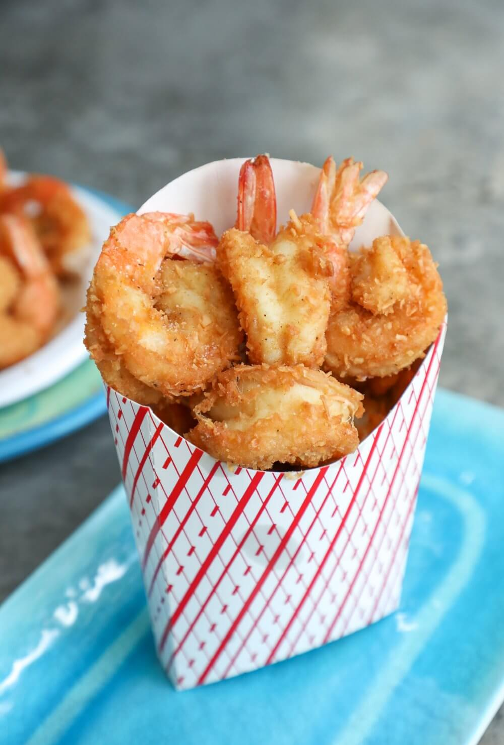 Keto Coconut Shrimp in a red and white striped paper dispenser