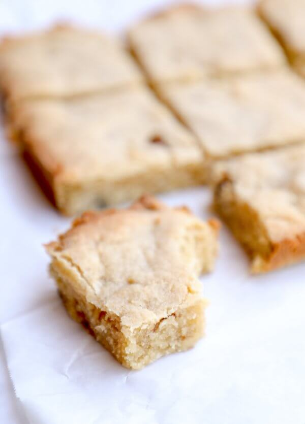Close up of a keto butter rum blondie with a bite taken out of it