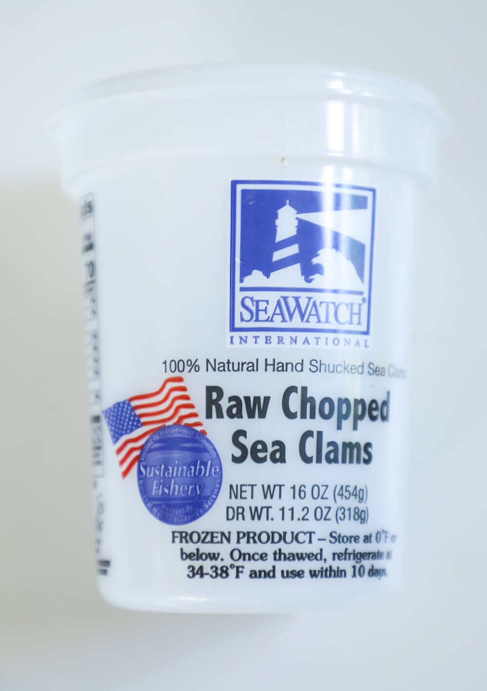 Empty container of raw clams used in this keto clam chowder