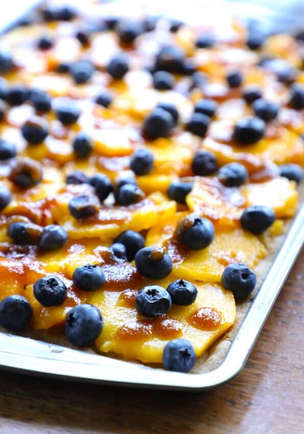 keto peach and blueberry slab pie on a cookie sheet before baking