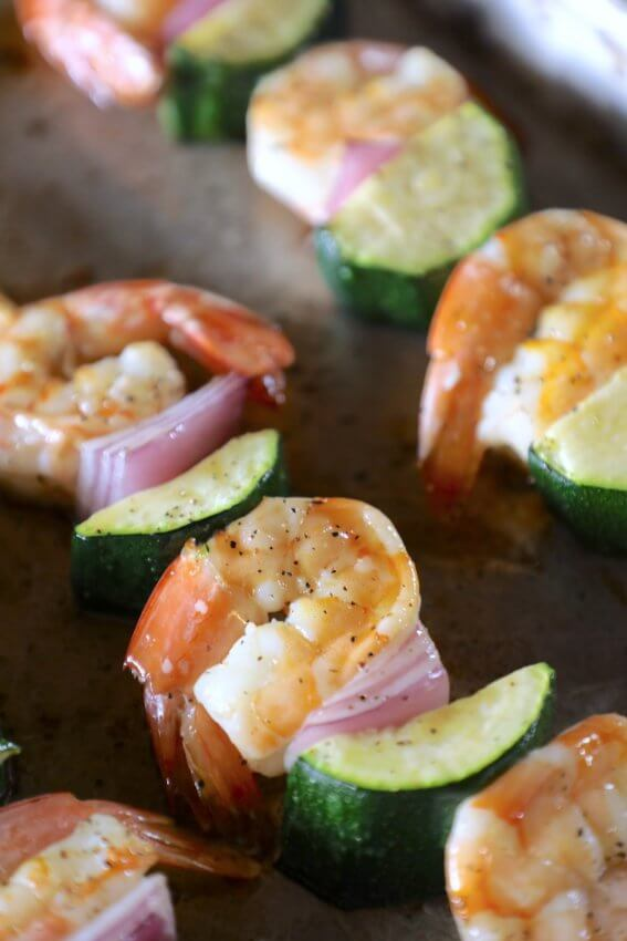 keto pesto shrimp skewers on a sheet pan after baking