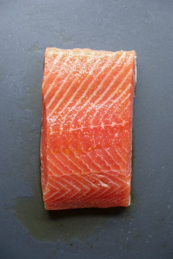 Filet of salmon on a sheet pan ready to be roasted