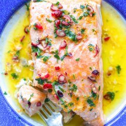 Keto Salmon with Cranberry Orange Butter on a blue and white plate
