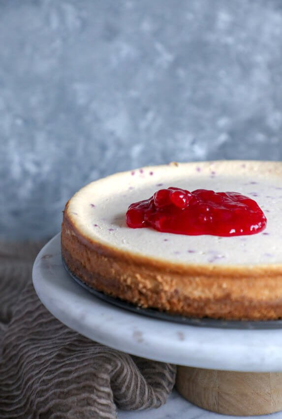 Keto cranberry orange cheesecake with the cranberry jelly spooned over the top