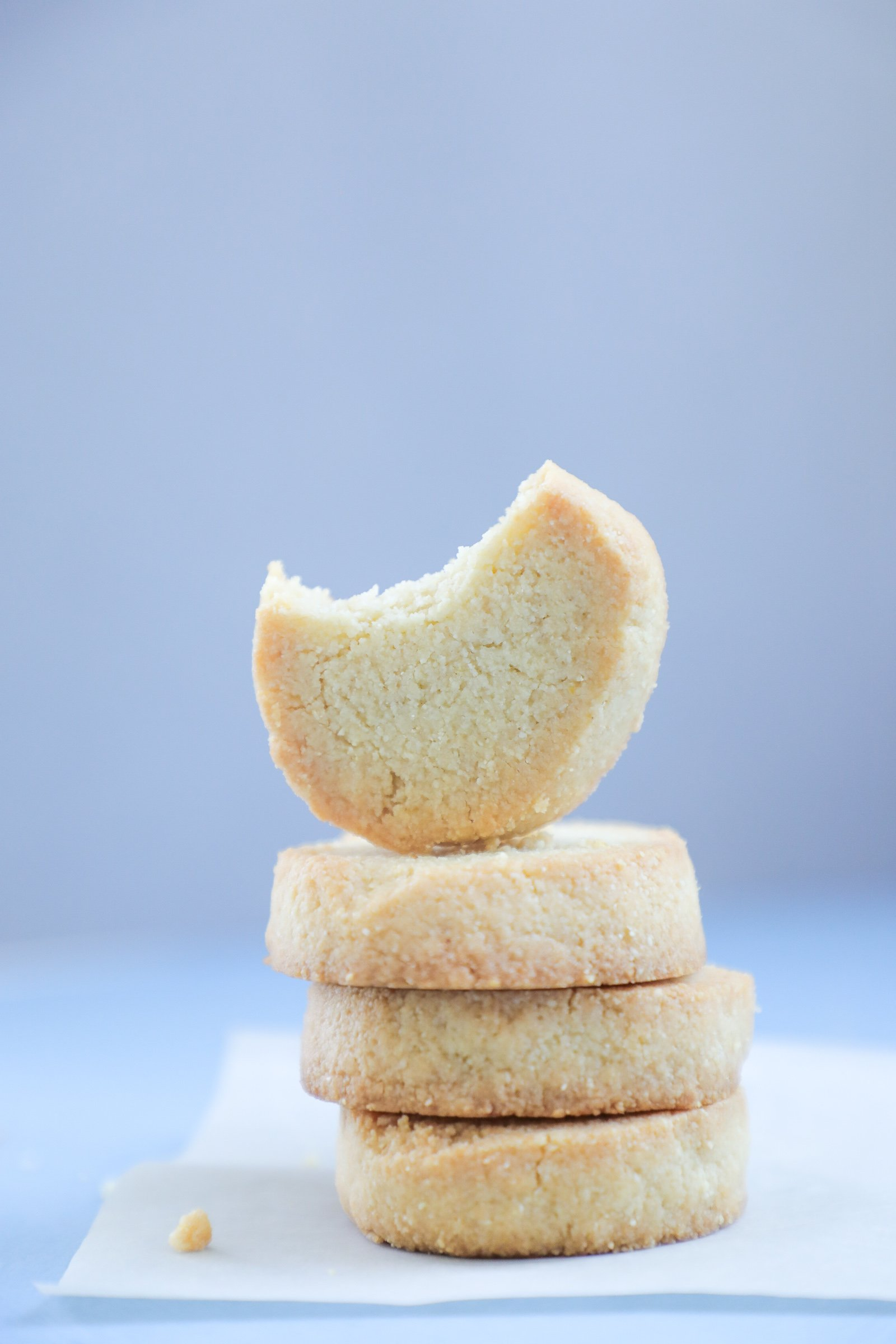 Keto Lemon Shortbread Cookie with a bite taken out of it.