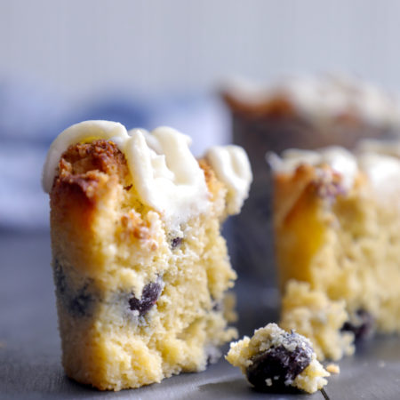 Keto Blueberry Muffins cross section with dripping lemon glaze