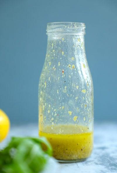 Keto lemon Dressing in a glass jar after shaking