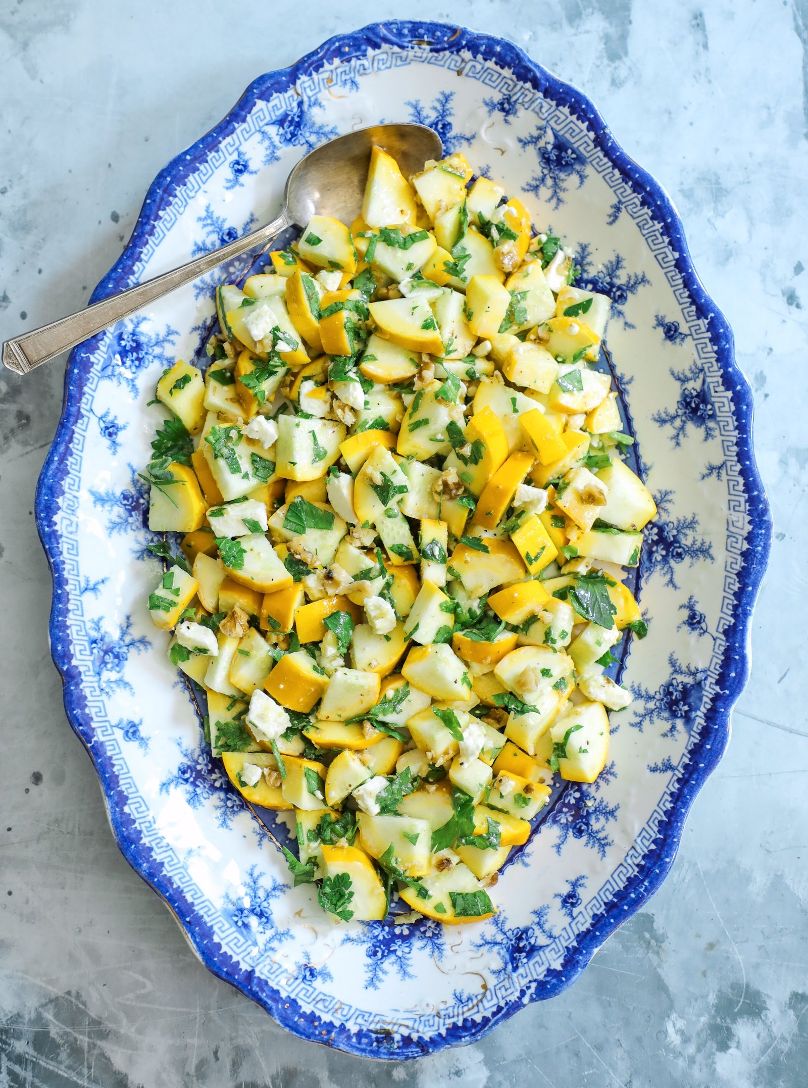 keto summer squash salad on a blue and white serving platter